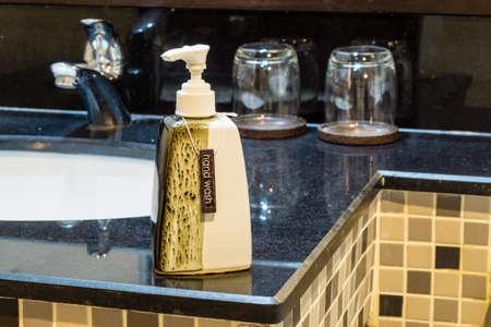 bath room: hand wash dispensers in bath room Stock Photo