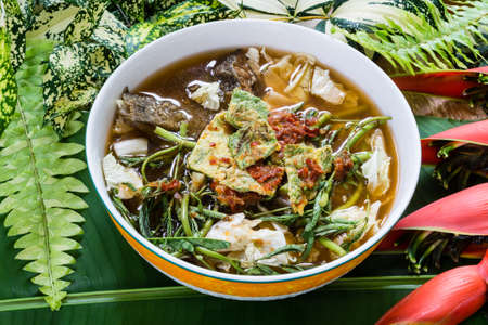 cha om: Thai Famous Food, Kaeng Som or Thai sour soup made of tamarind paste Stock Photo