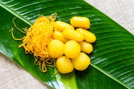 yoke: Thai Dessert - Sweet egg floss and egg yoke fudge balls cooked in syrup