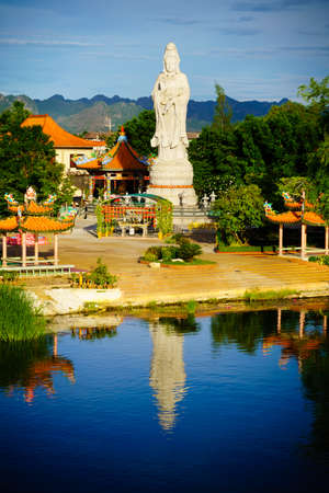 goddess of mercy: Buddhist goddess of mercy. Statue in chinese temple near river kwai bridge, kanchanaburi, Thailand