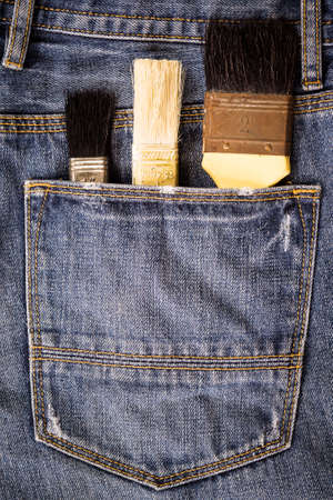 stride: paint brushes in jeans pocket