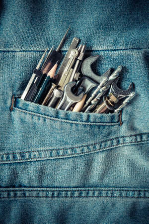 borer: Tools in Jeans pocket background concept