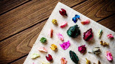 gory: aromatherapy potpourri mix of dried aromatic flowers on wooden background Stock Photo