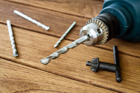 gimlet: power drill closeup on wooden background