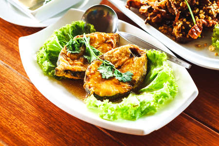 Thai Food - deep fried mackerel fish with soy sauce