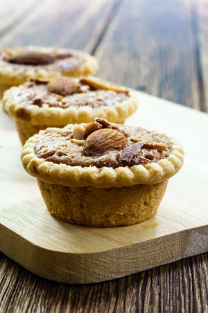 Homemade Almonds tart on wooden table background Stock Photo