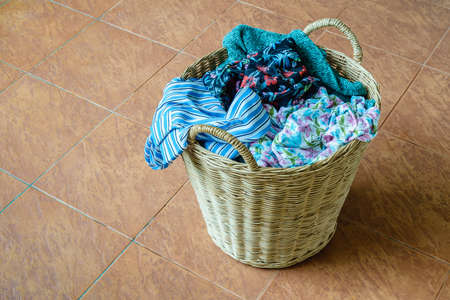 unwashed: Pile of dirty clothes in a washing basket Stock Photo