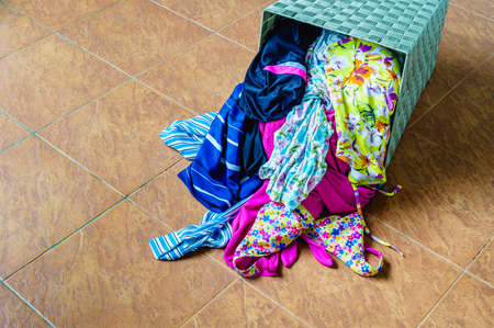 household chore: Pile of dirty clothes in a washing basket, Household chore concept. Stock Photo