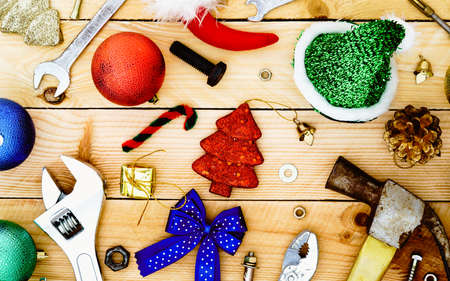 Handy Tools with Christmas decoration on wooden Background Copcept
