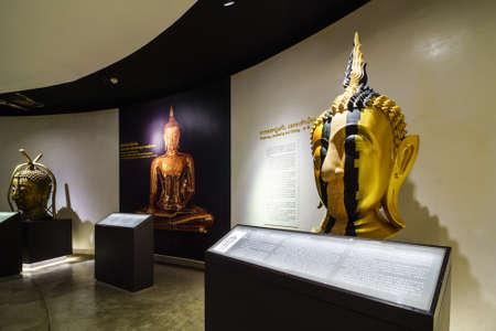 emergence: BANGKOK, THAILAND - DEC 18 : The Golden Buddha, Phra Buddha Maha Suwanna Patimakorn exhibition show the miracle of the worlds biggest golden buddha: the construction, concealment and emergence  on December 18, 2016 at Wat Traimit Temple, Bangkok, Thailan Editorial