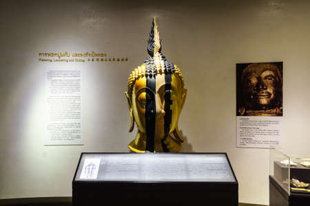 wat traimit: BANGKOK, THAILAND - DEC 18 : The Golden Buddha, Phra Buddha Maha Suwanna Patimakorn exhibition show the miracle of the worlds biggest golden buddha: the construction, concealment and emergence  on December 18, 2016 at Wat Traimit Temple, Bangkok, Thailan Editorial