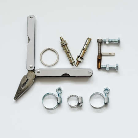 long nose: Fathers day concept - Love Dad texts with Long Nose Plier, bolts and nuts