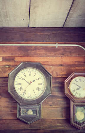 watchmaker: vintage wall clock on wooden wall Stock Photo