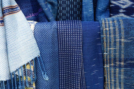 Texture of traditional Indigo blue natural Thai clothes, Thai traditional natural colour, Indigo dyed clothes background.