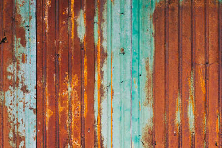Rusty Zinc Background. Grunge texture of old rusty metal with scratches and cracks background. Old and rusty damaged galvanized texture. Stock Photo