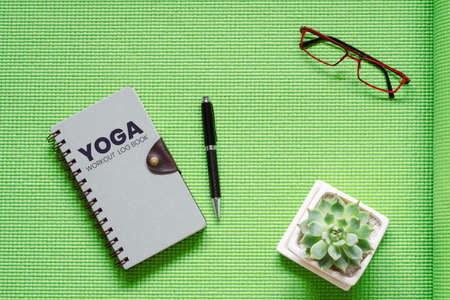 yoga workout log book concept flat lay top view of yoga workout
