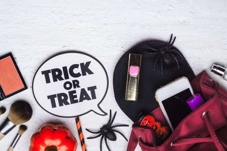 Happy Halloween Festival with female beauty accessories cosmetic fashion flat lay concept.