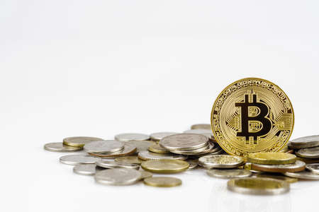 Golden bitcoin over many international money coins isolated on white background. Crypto currency concept. Bitcoin cryptocurrency background concept with copy space.