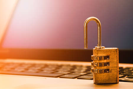 Computer information security and data protection concept, padlock on laptop computer keyboard.  Computer security protection from virus,  malware attack, online cyber crime and hacking background concept.