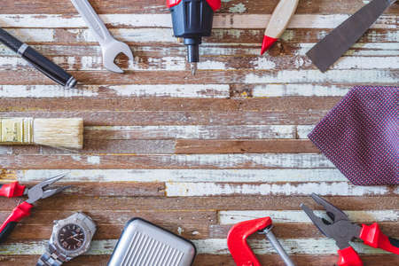 Labor's day and Worker's day background concpet. Blue collar's handy tools and White collar office men's accessories on grunge wooden table texture background.