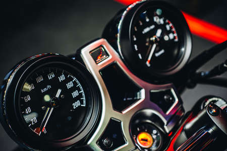 Close up detail shot of dashboard display of speedometer & analog gauge of modern sport motorcycle. Stok Fotoğraf