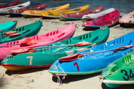 Many colorful old Canoes Kayaks on the beach at Nang Rum Beach, Sattahip, Chonburi, Thailand