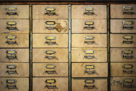 Vintage retro old chinese medicine  metal cabinet texture background. Drug drawer, drug shelf, vintage drawer, Chinese herbal medicine storage.