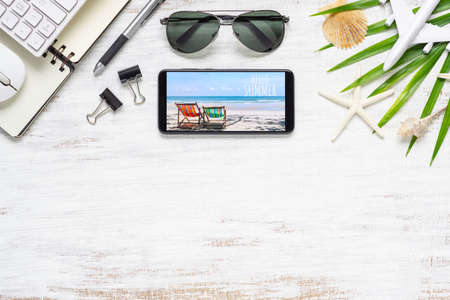 Smartphone mock up template with summer beach planning travel concept. Top view of planing travel and technology background concept. Flat lay. Reklamní fotografie