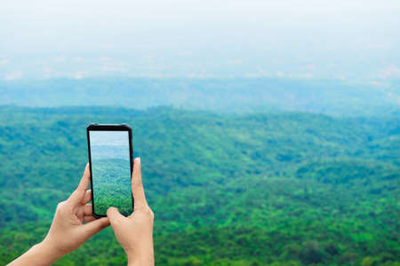 Traveller make photo on smartphone, using phone in hand, travel blogger, Close up of womens hands holding smartphone taking picture