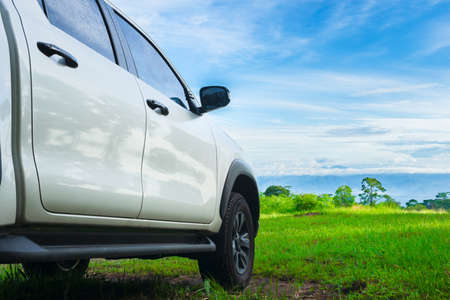 Traveling by car. Freedom car travel in holiday background concept with green nature and bright blue sky. Travel with pickup car in nature, rural tropical forest in the summer. Reklamní fotografie