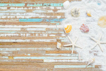 Summer time background concept. Sea shells and starfish on a grunge retro vintage wooden background. Starfish with sea shell collection background. Flat lay with copy space.