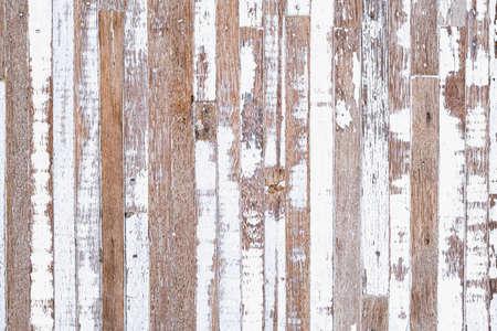 Grunge background. Peeling white paint on an old wooden background. Old Rustic Wood background. Vintage retro background. Archivio Fotografico - 129272386