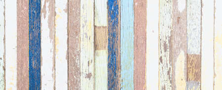 Grunge background. Peeling paint on an old wooden background. rusty weathered wood planks.