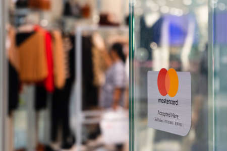 Bangkok, Thailand - September 22, 2019: Mastercard accepted and welcome sign in front of a clothing shopping store in in Bangkok, Thailand.