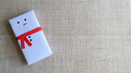 Christmas background with copy space. Top view of DIY Snowman gift boxes . Celebration of winter holidays concept