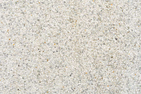 Gravel stone wall texture. Small gravel wall Mix with white, black gray stone to make a wall.