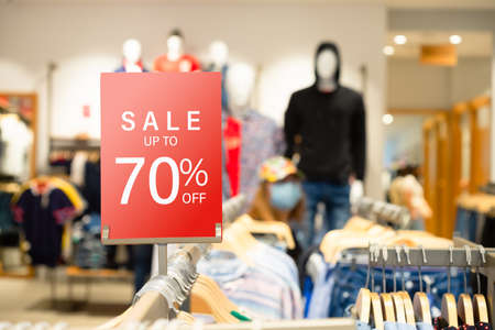Sale label stand template on shelve in male clothing store for sale promotion and discount information for Black Friday and Holiday season sale. Sale Banner template mockup. Discount sale 70% red sign in shopping mall. Stockfoto