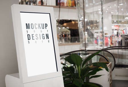 Mockup blank white screen signboard lightbox with blurred modern luxury shopping mall for your advertisement text or artwork.