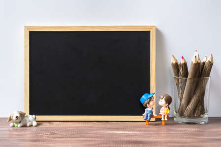 Mockup blank black chalkboard for your text or artwork. Frame with a copy space. Lover background concept.