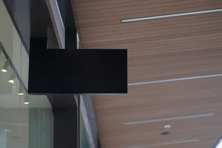 Blank black mockup of modern store signboard with modern architecture and glass windows.  Mock up empty signage.