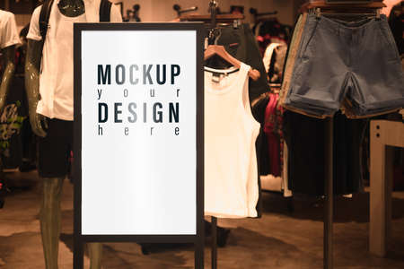 Mockup blank white screen sale advertisement billboard lightbox mockup. Poster advertisement light board mock up infront of male fashion shop. Stockfoto