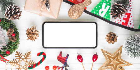 Mockup blank white screen smartphone on white desk background for Christmas. Wide Angle Template for design. Panoramic Web banner with copy space
