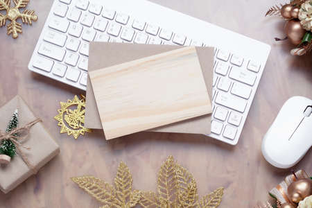 Mockup Christmas New Year concept. Mock up blank empty space wood board with Christmas decoration ornaments, New Year gifts on home office desk table background, top view. Zdjęcie Seryjne