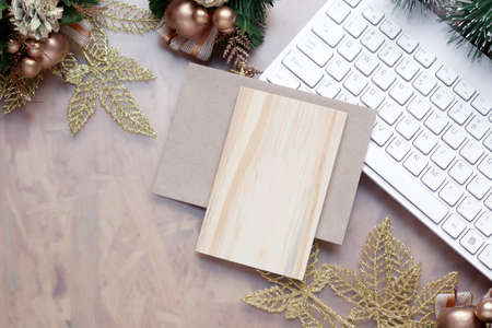 Mockup blank empty wood board for Christmas greeting card top view  flatlay on a wooden background, with place for your text for Merry Christmas and Happy New Year festive background. Zdjęcie Seryjne