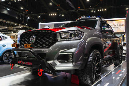 Bangkok, Thailand, March 29, 2021 : New silver pickup truck new model of MG Extender parking for sale at Thailand International Motor show. New MG Extender on Display.