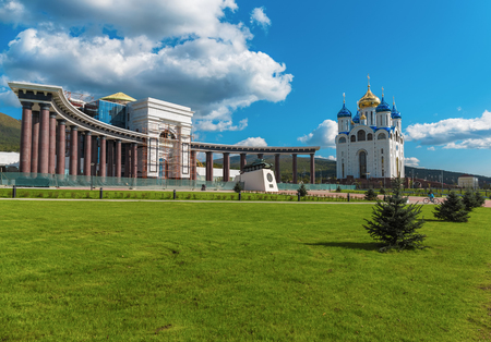 sakhalin: Sakhalin domed Cathedral, the sun summer building a beautiful blue sky, clouds, green grass