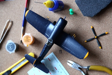maquette: A blue plane model set up and tools are on the table  Stock Photo