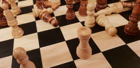 How to play wooden board game chess. Improvisation and Different angles of chess sets, pieces and chessboard. White and black figures and board of chess game. Stock Photo