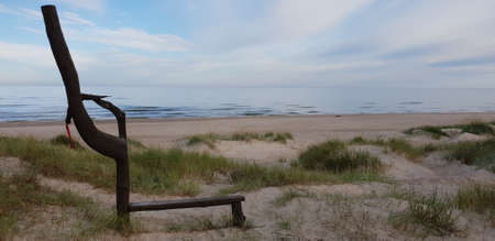 The bench made from tree in the Baltic sea beach