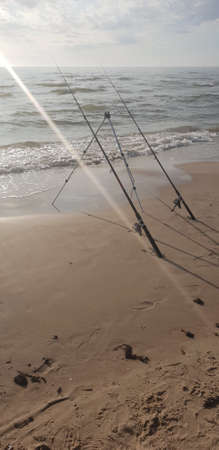Fishing rods in the Baltic Sea beach